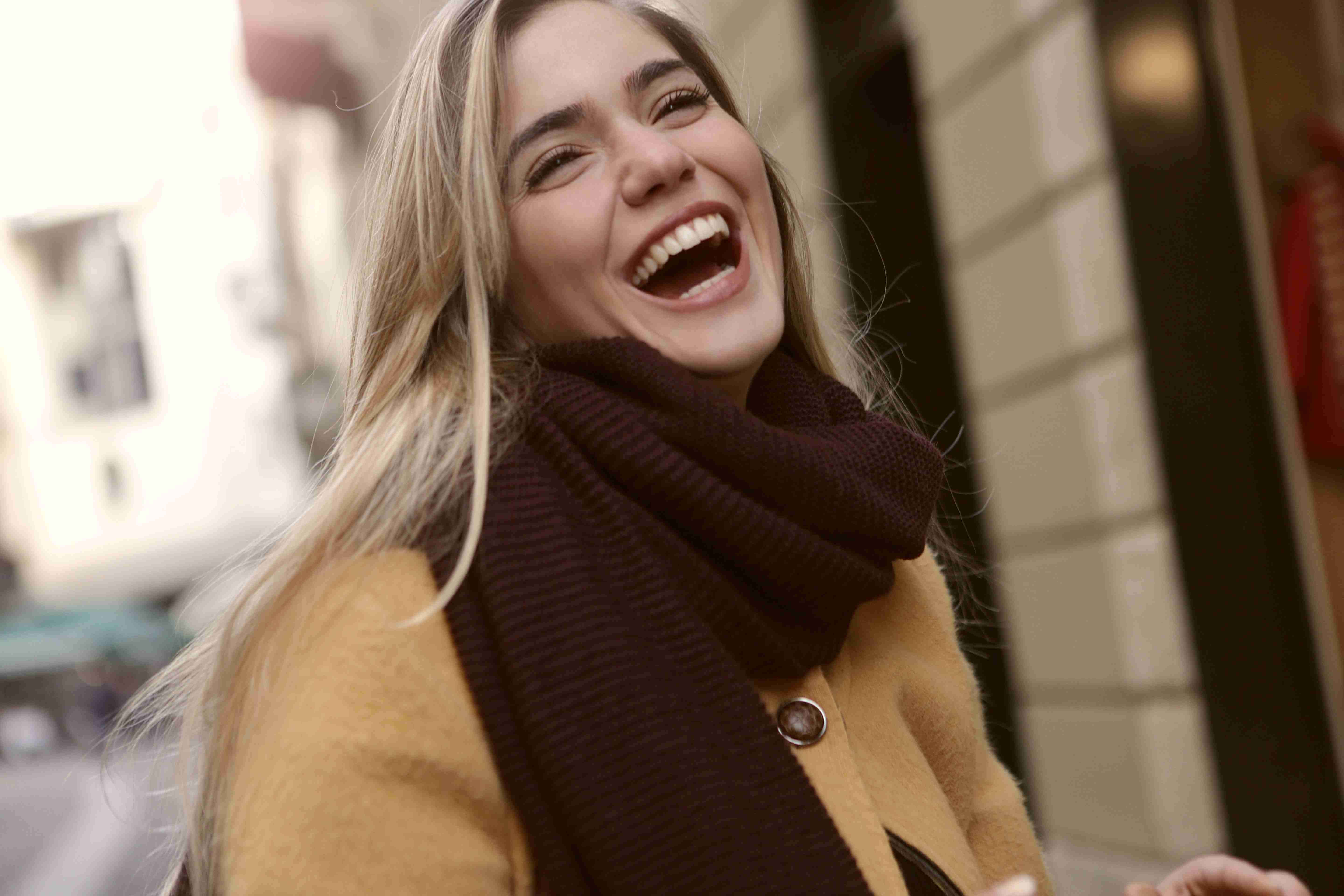 A young beautiful girl laughing