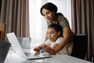 child counselling - a mother teaching her daugher online