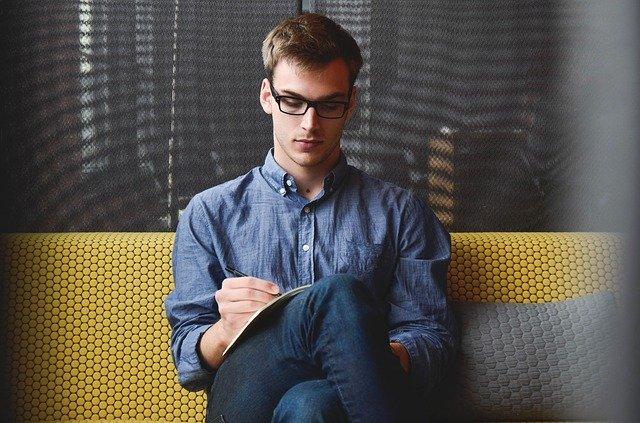 an entrepreneur sitting on sofa plaaning his startup