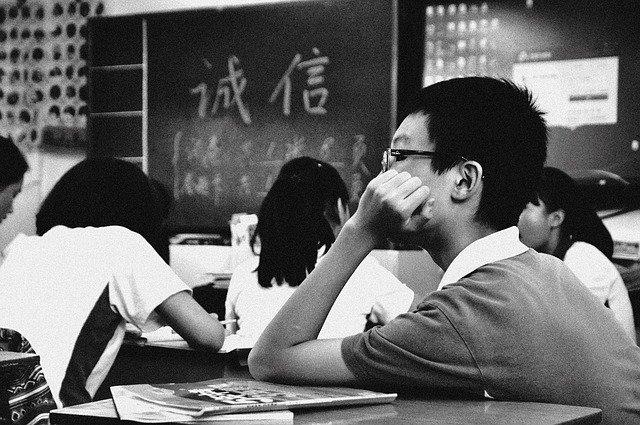 a anxious boy sitting in exam