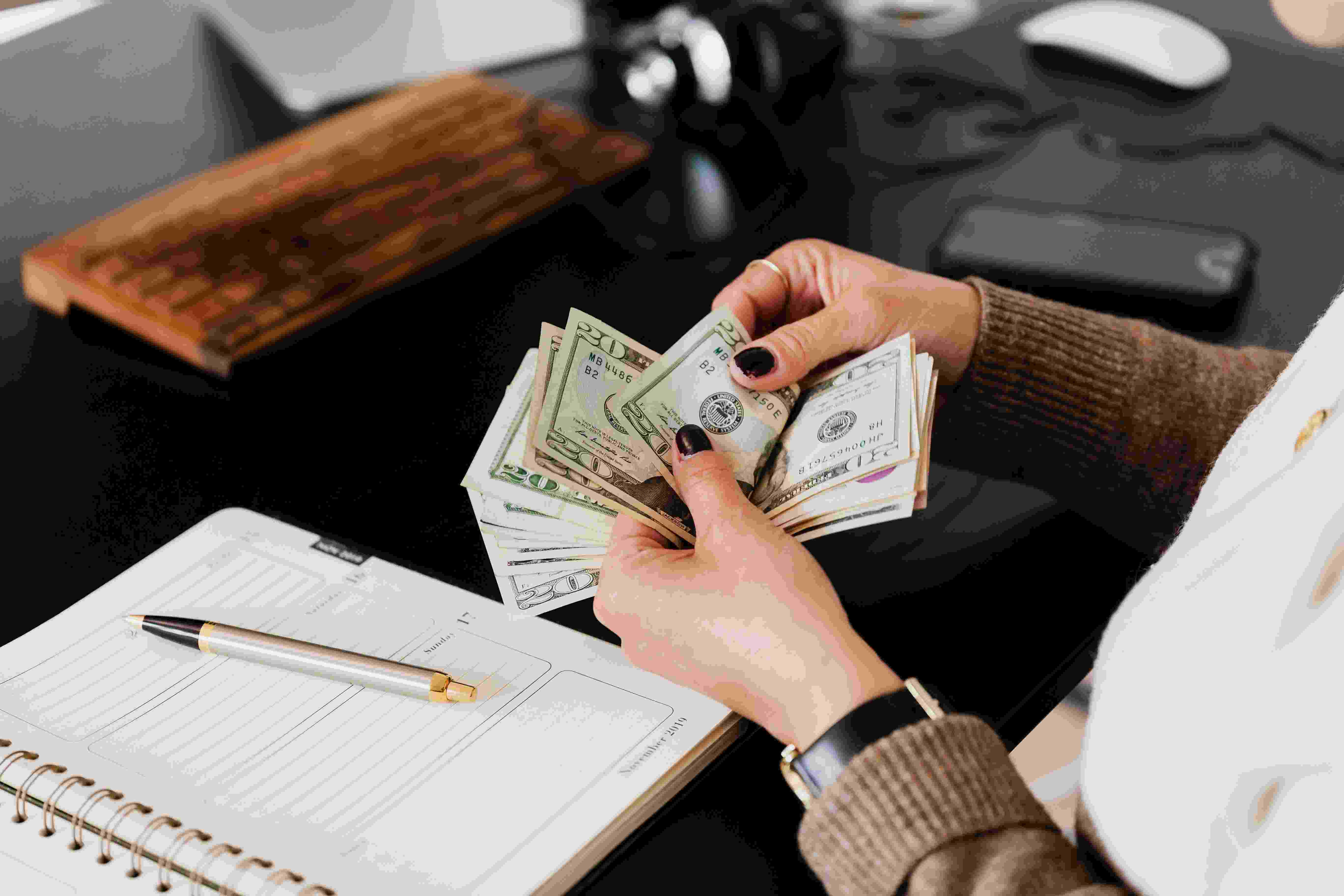 a women counting money and managing finances