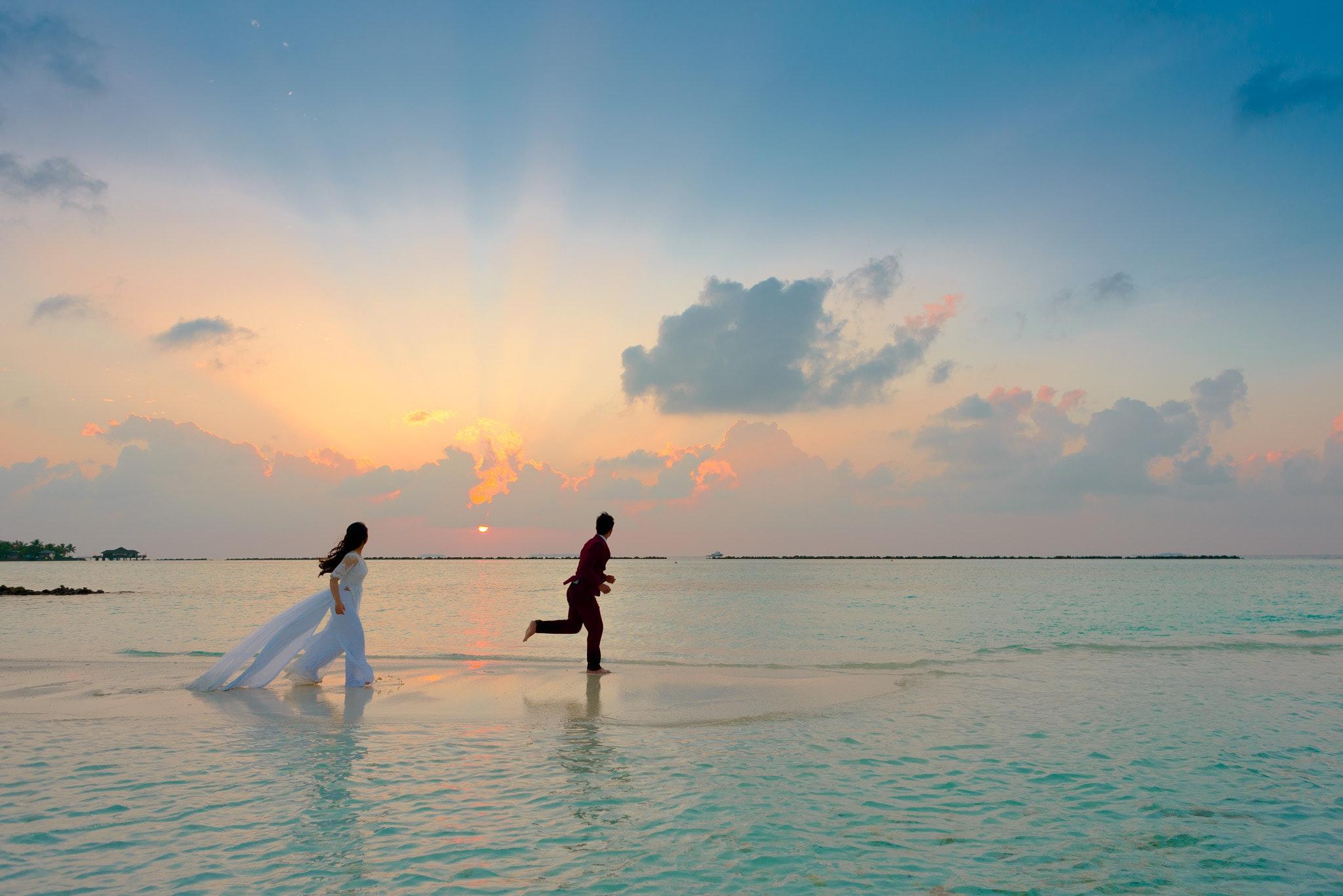 a couple running near the beautiful beach
