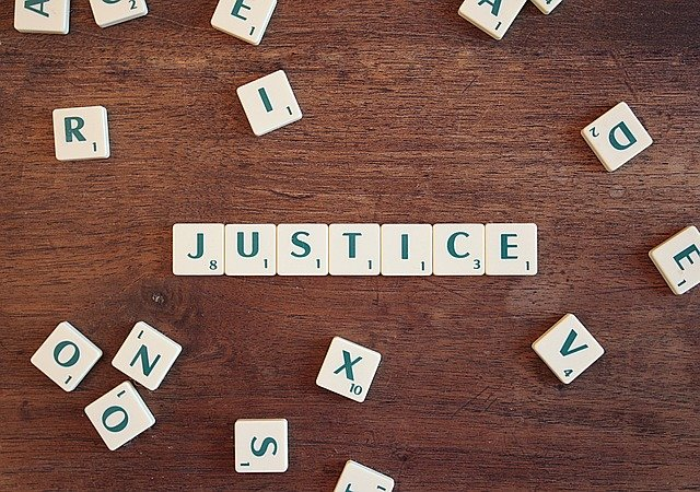 justice written on small pieces