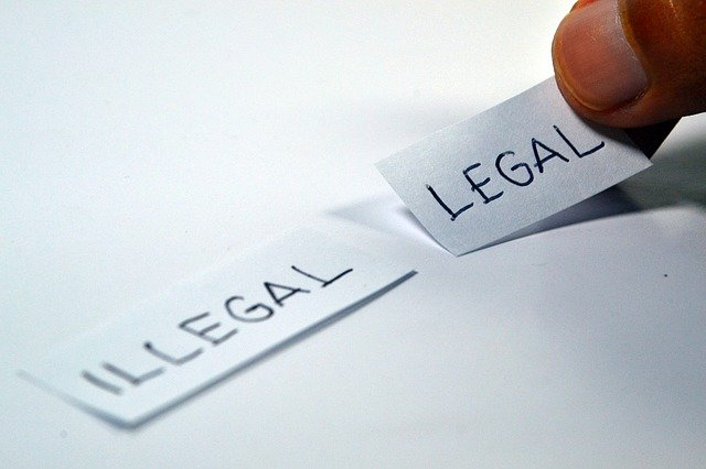 Legal and illegal written on white page piece