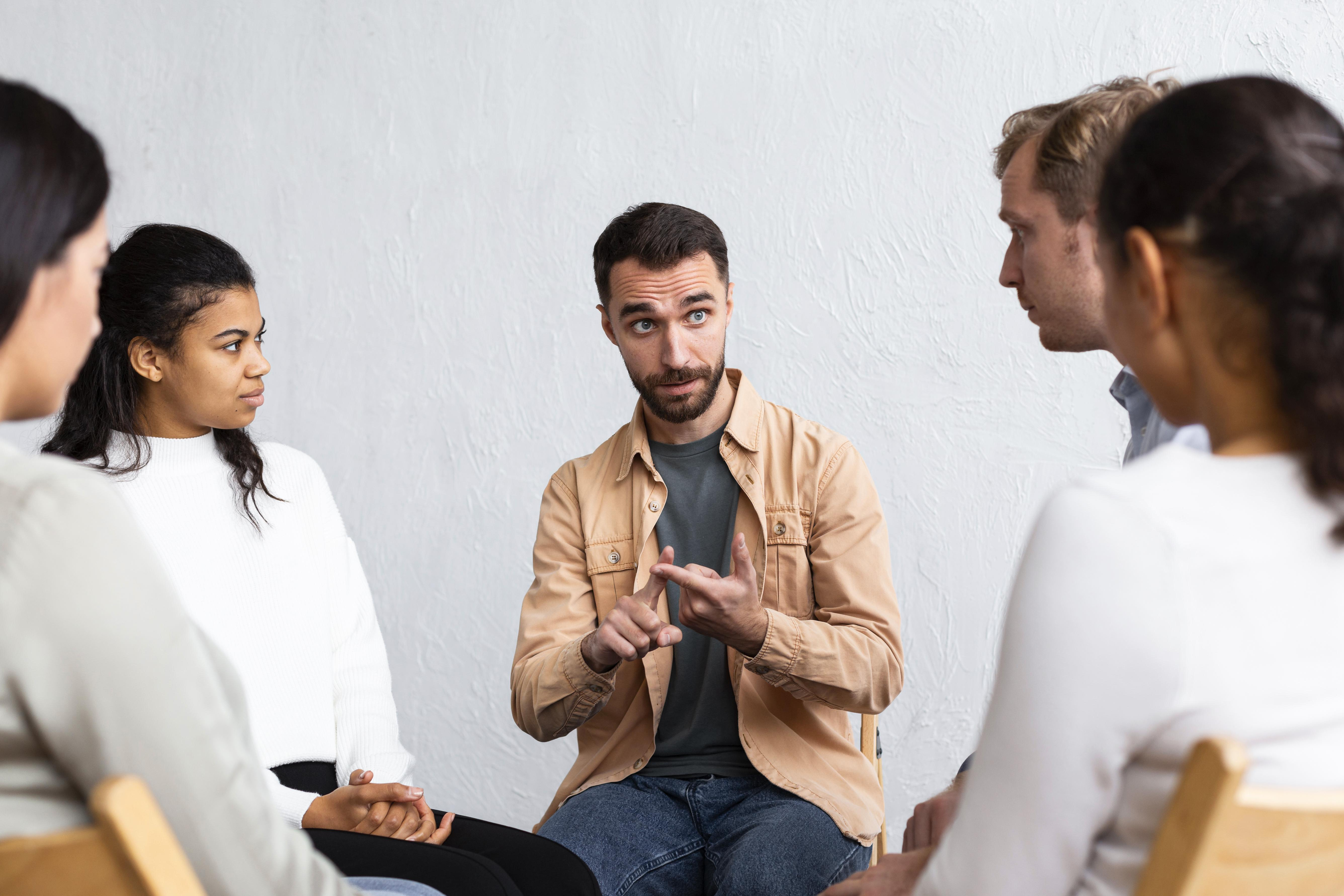 Man explaining his problems in group therapy session