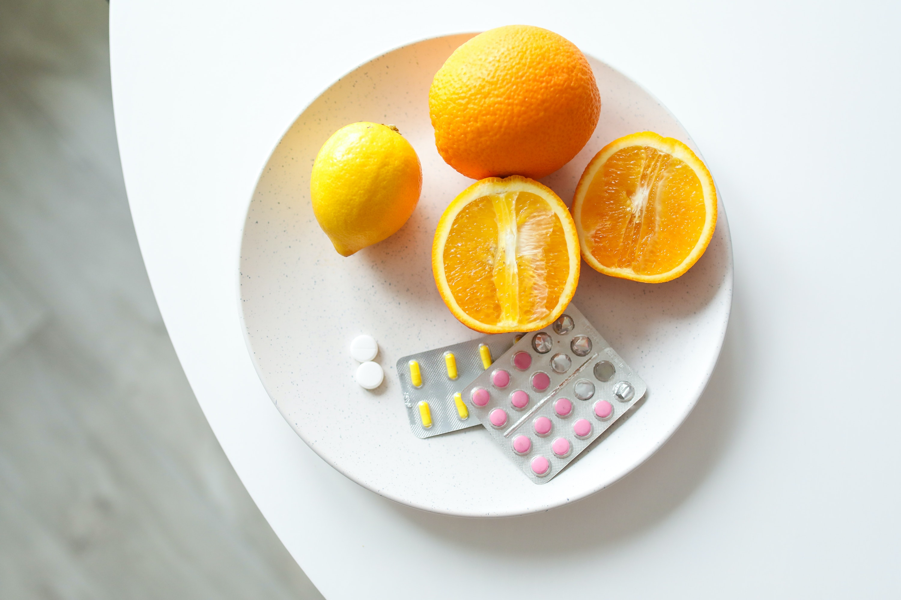 orange and medicines in a white plate for borderline personality disorder