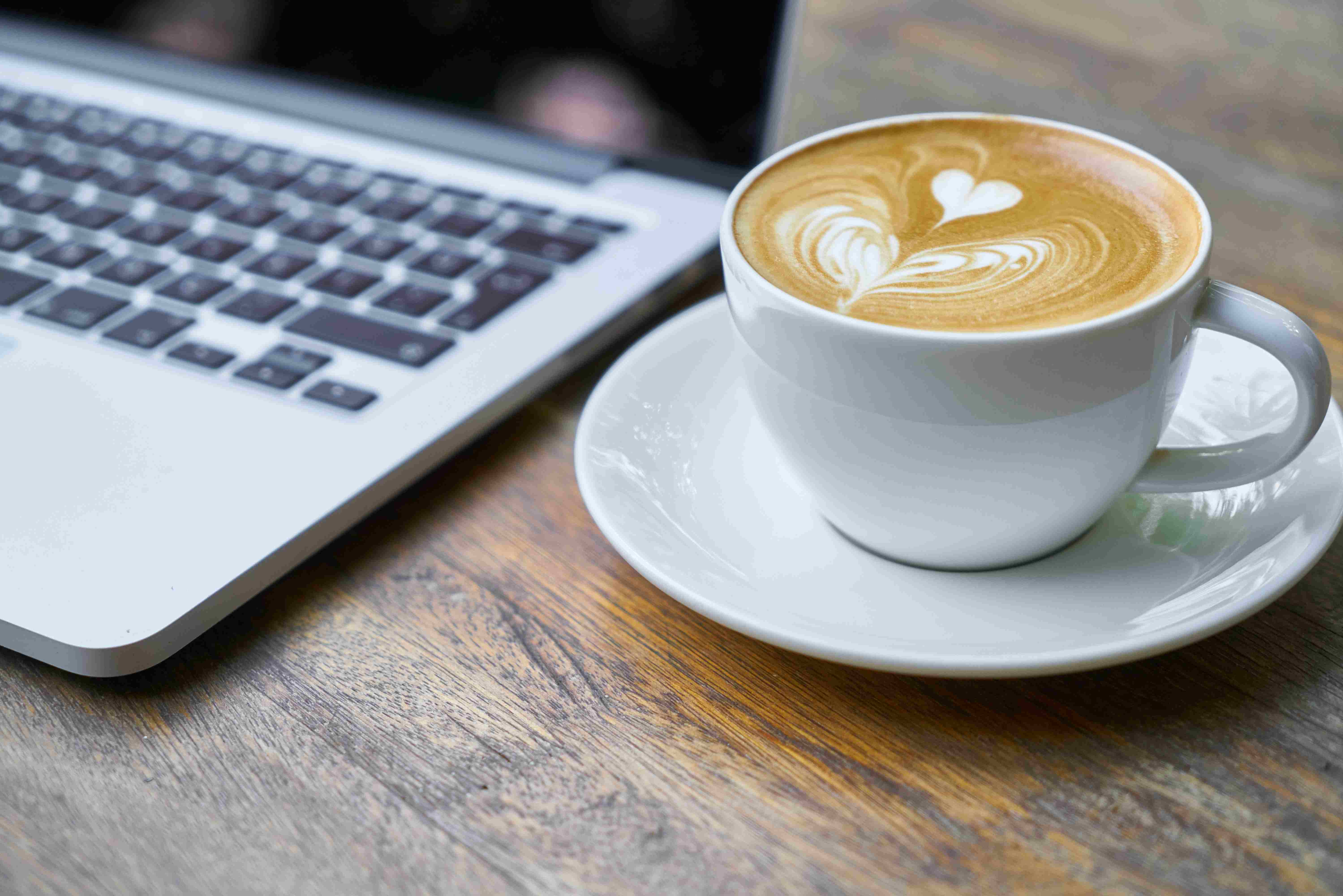 a cup of coffee on table in office break
