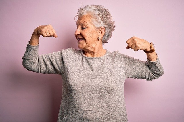 A old women showing her biceps