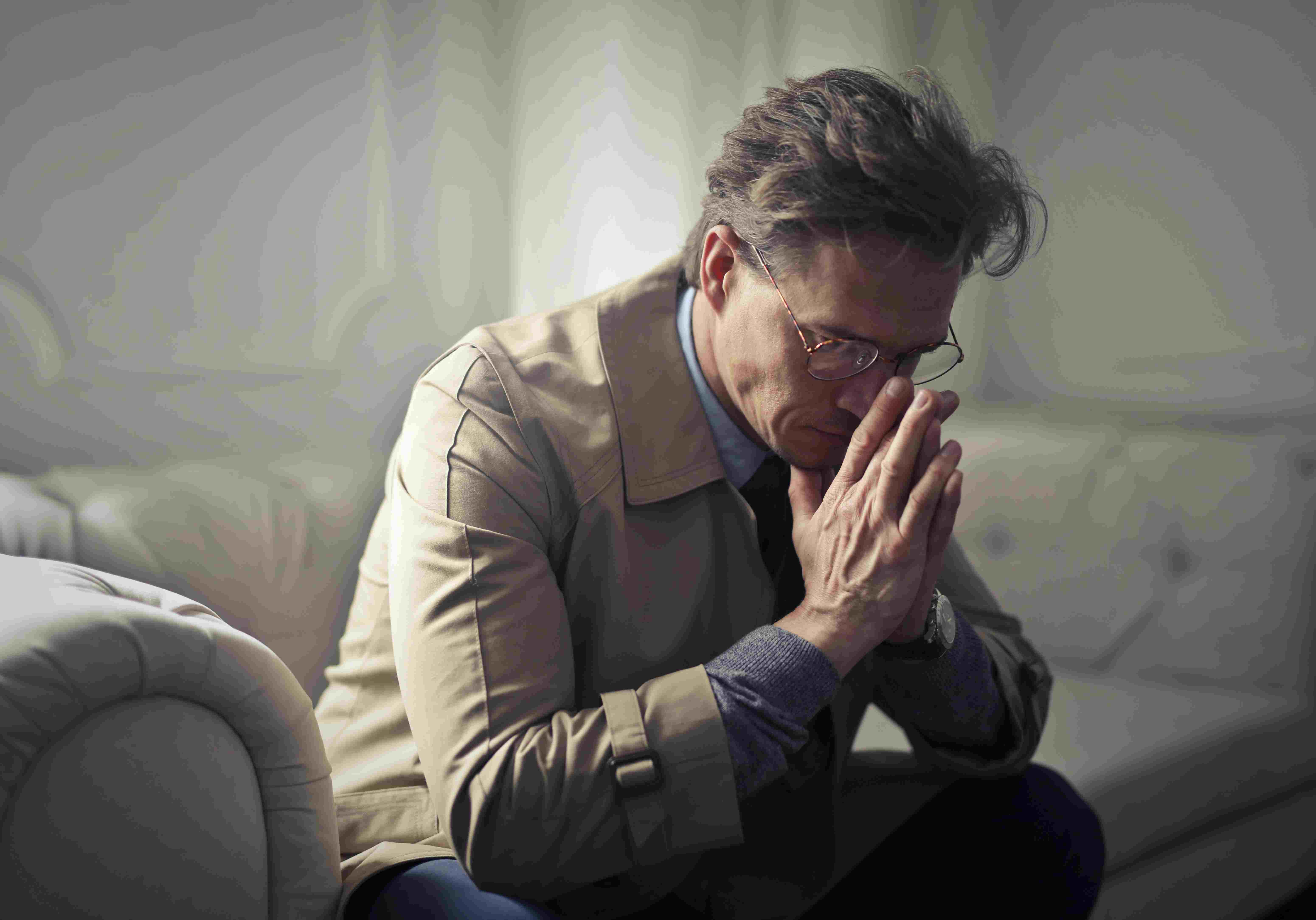a sad depressed man thinking deeply