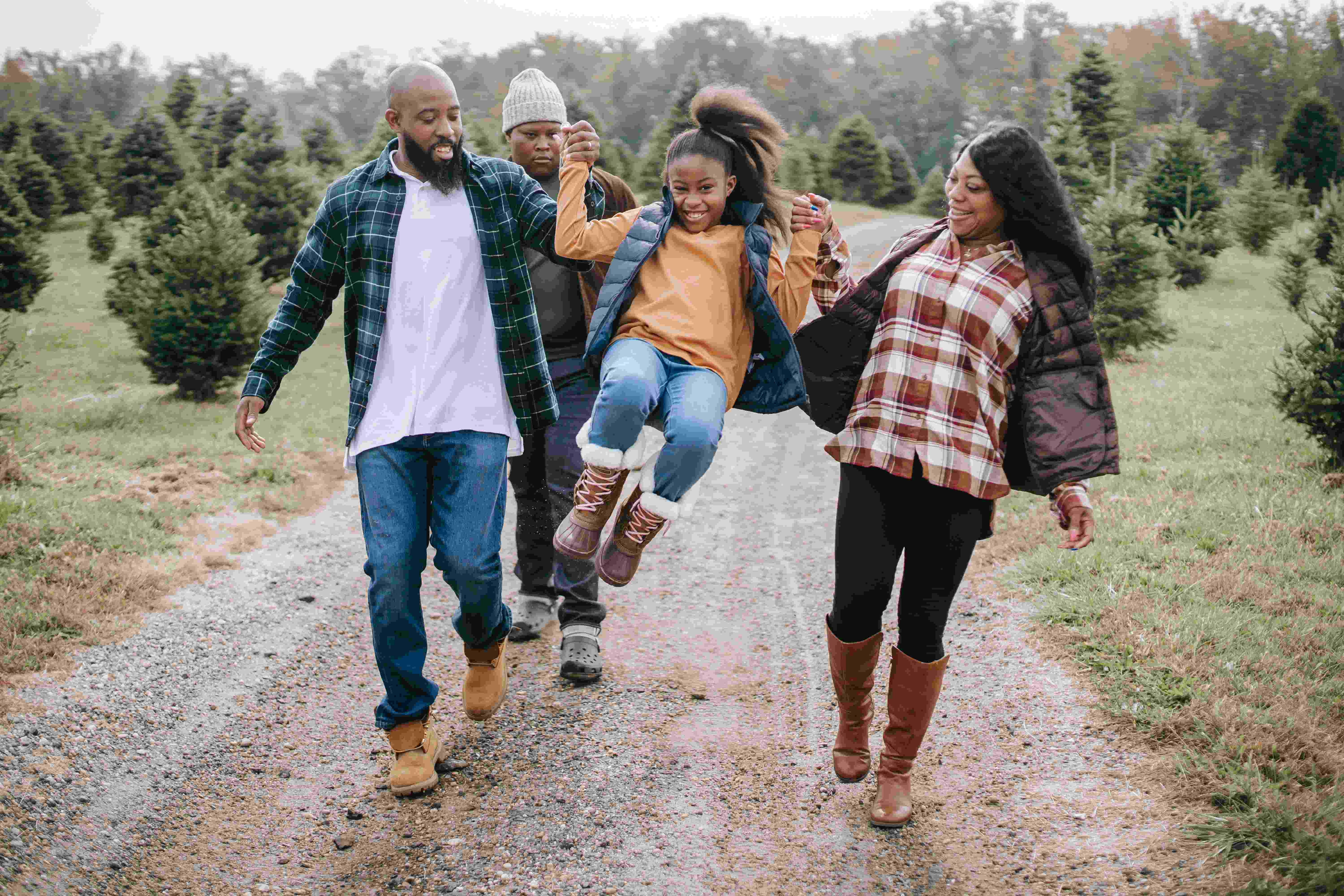 A family of 4 African-American Enjoying outside in cold weather