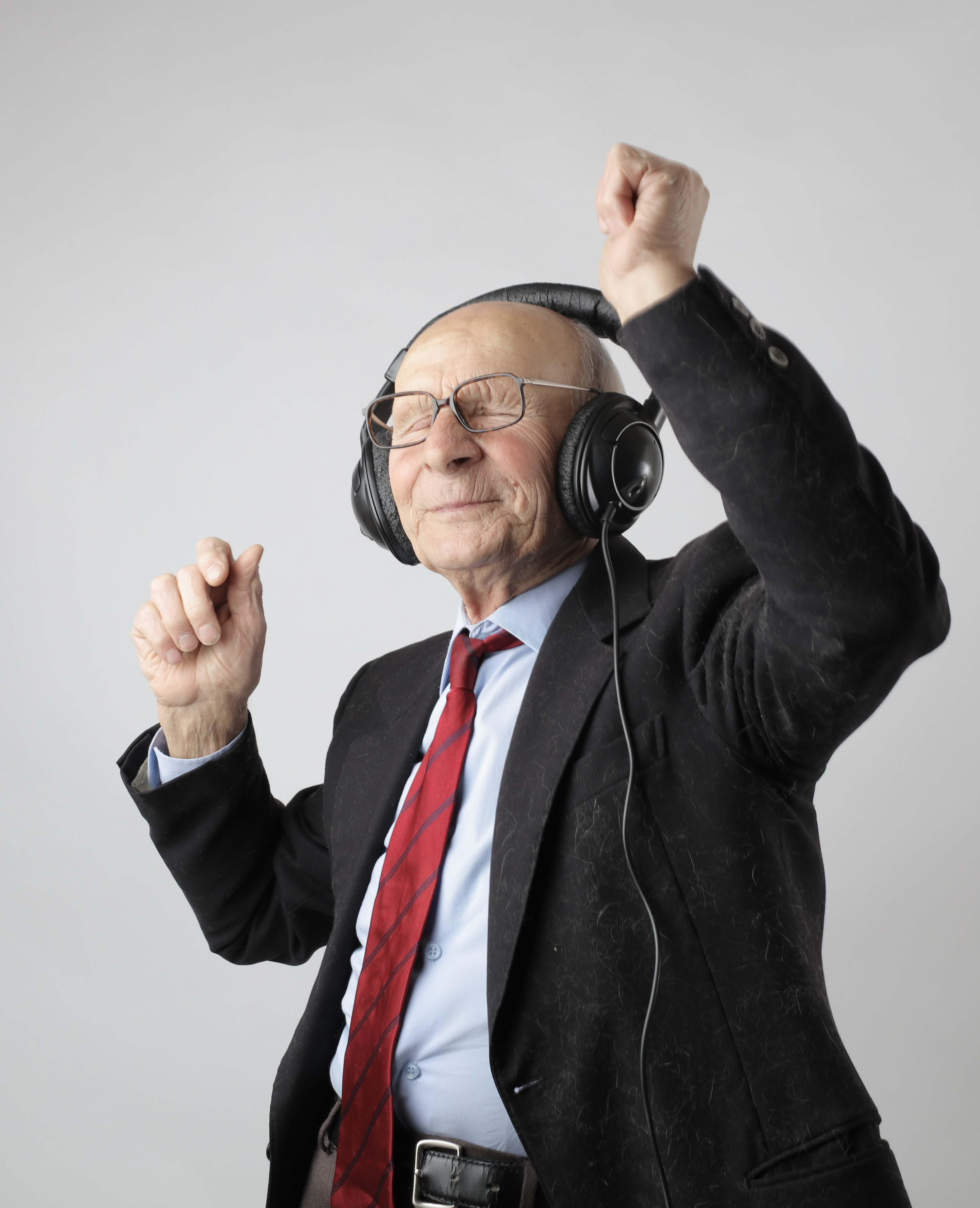 an old man listening music happily