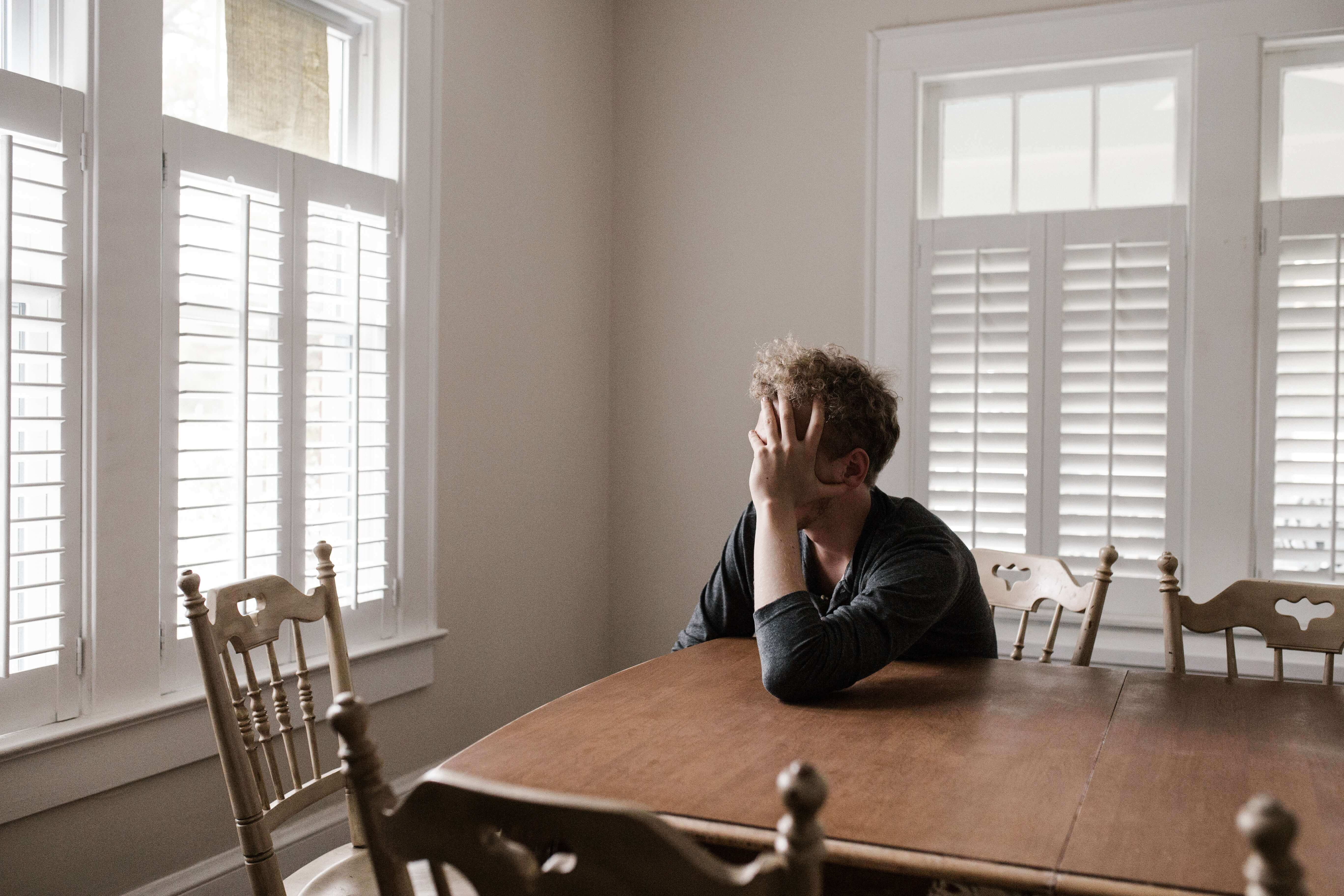 a man sitting on the dining table